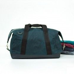 Duffle bag with handles and a shoulder strap.