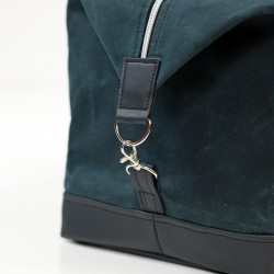 How to sew a duffle bag with faux leather accents.