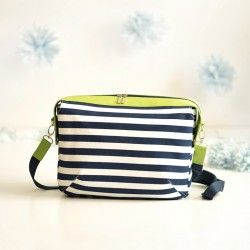 Learn how to sew a zippered bag with a lining and a shoulder strap.