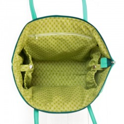 Bag's lining features 2 large pocet with snap cloure and one large, zippered pocket.